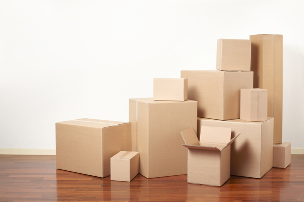 Cardboard boxes stack in apartment, moving day